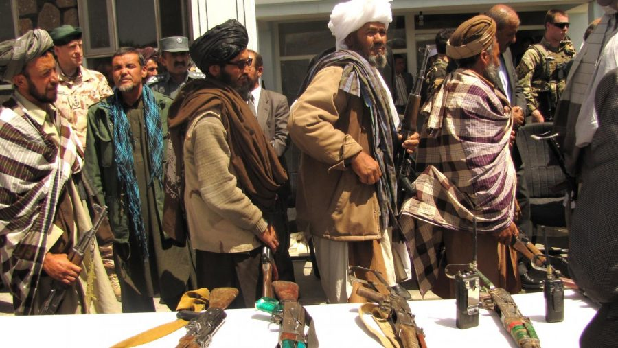 Taliban fighters move through Afghanistan.