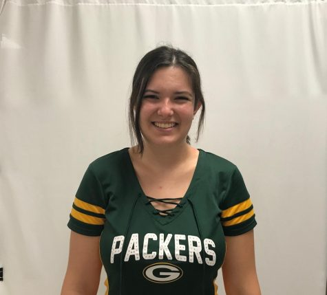 A Green Bay fan since birth, Gracie Martin (22) roots for the Packers with her Wisconsin family.