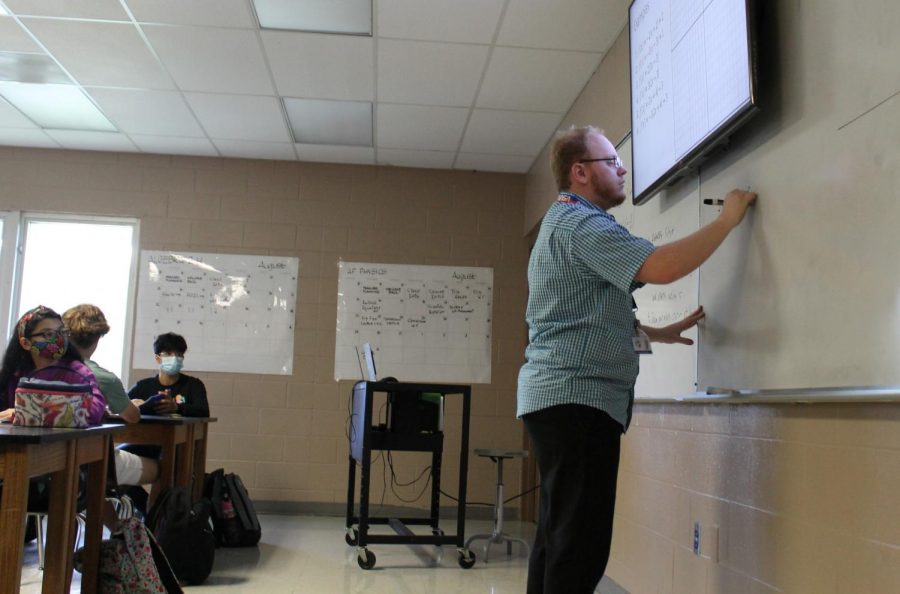 Teaching+his+students%2C+Edward+Willoughby+%28FAC%29+deepens+the+knowledge+of+the+future+generation.+Willoughby+taught+earth%2Fspace+science+to+a+multitude+of+students.+%E2%80%9CI+do+have+hope+for+the+future+as+slim+as+it+might+be%2C+as+cynical+as+I+can+be.+I+think+if+the+people+in+our+government+take+action+now%2C+we+can+turn+this+whole+thing+around+and+I+prefer+the+planet+to+be+nowhere+between+a+cold+wasteland+or+a+barren+desert%2C%E2%80%9D+Willoughby+said.+Photo+by+M.+Hernandez+