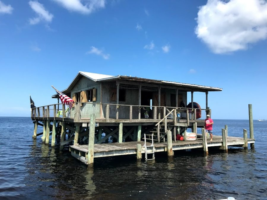 Labor Day weekend, Jake Misemer, father of AJ Misemer ('23) walks across the deck of the family stilt house. The family arrived by boat that morning from Port Richey. Photo taken by Ms. Susan McNulty (FAC).