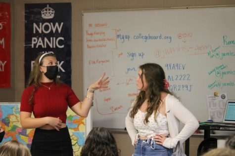 Sofia Chianella (23) and Brooke Ealy (23) lead their fellow GEM club members through an informational presentation at the first club meeting on Aug. 25. Photo provided by: Kole Kemple
