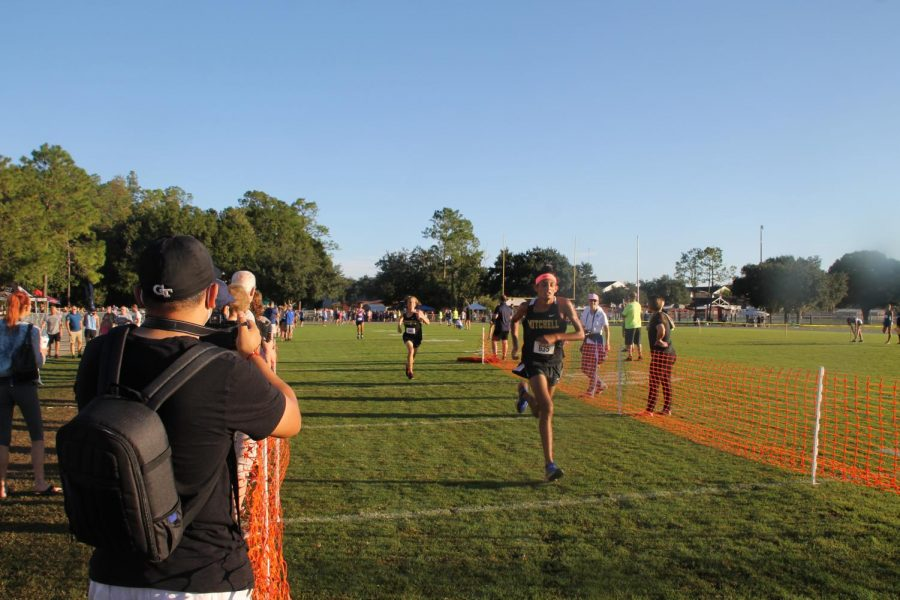 Trystan Capille ('23) sprints to the finish line with Brady Pavlica ('24) close on his tail. Capille crosses the line, and within two seconds Pavlica reaches the finish line as well.